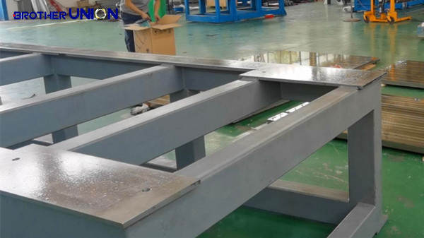 A rigid roll forming machine base, with top plate machined